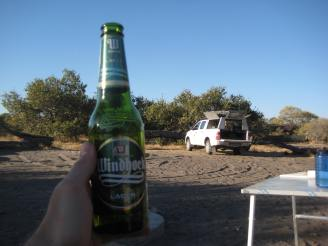 Enjoying a beer in the Savuti site
