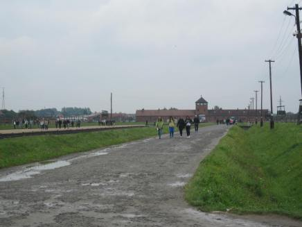 Looking back towards the entrance to the camp. Prisoners would come through the gate in cattle cars and be processed where the people on the left were standing. Many would be sent straight to the gas chambers.