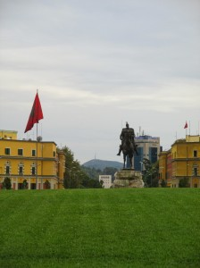 The statue of Skanderbeg in the middle of the square. The Italian-inspired government buildings are in the background.