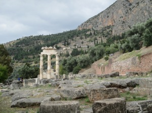 The Tholos and the Sanctuary of Athena with the Santuary of Apollo on Mount Parnassas in the background