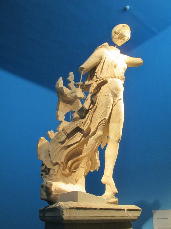 Nike - goddess of Victory. She stood on a pedestal where the Olympic victors were crowned near the Temple of Zeus