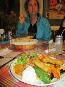 The Turkish combo platter is in the foreground. Della is enjoying her Korean bibimbap in the background
