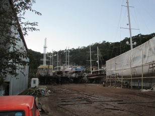 The shipyard had many boats in various states of construction and repair
