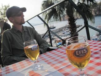 Enjoying an Efes beer overlooking the harbor