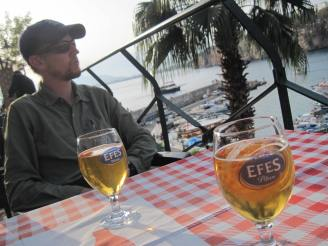 Enjoying an Efes beer overlooking the harbor