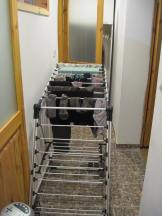 The drying rack took up the whole hallway