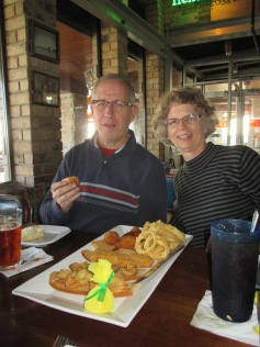 Eric's parents getting ready to eat the fried sampler platter at Nick's