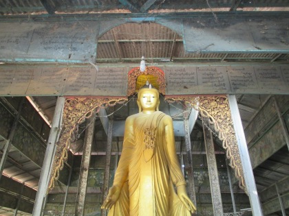 A wooden Buddha a few pagodas up