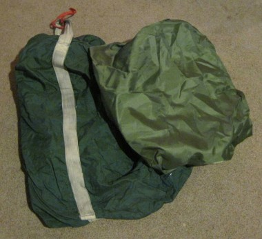 Bag on the left wraps the pack for flight. The cover on the right is for rain