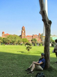 Relaxing in Mahabandoola Park, with the High Court in the background
