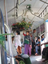Flower sellers somehow able to balance their wares on their head