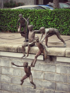 A pretty interesting scultpture of boys jumping into the river