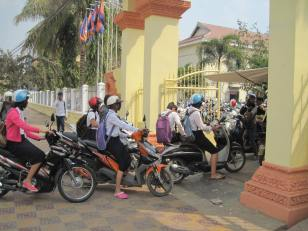 Students taking their motor bikes to school