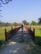 Riding a bridge over a moat