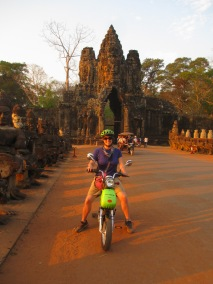 Iconic gates of Angkor Thom at sunset