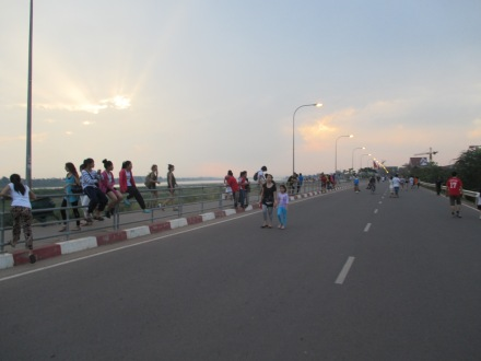 People exercising along the river