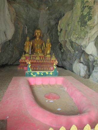 Buddha at entrance to cave