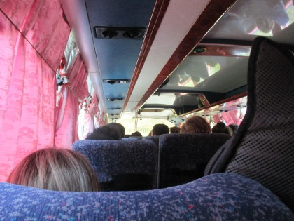 crowded bus with most seats broken
