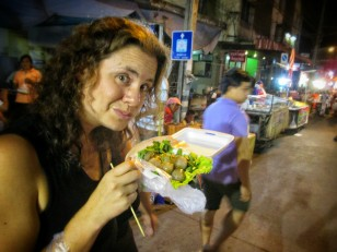Della enjoying a street treat in Sukhothai