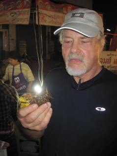 Wayne about to eat a bug at a night market