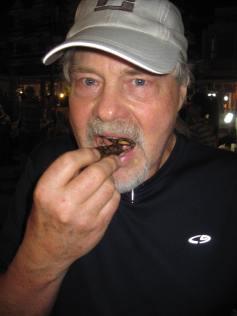 Wayne eating a bug at the night market