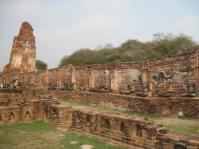 Disintigrating walls and broken Buddha images