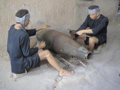 A recreation of Viet Cong Guerillas disarming and stealing explosive powder from a UXO