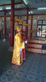 Tourists can pay to dress up as a mandarin for pictures