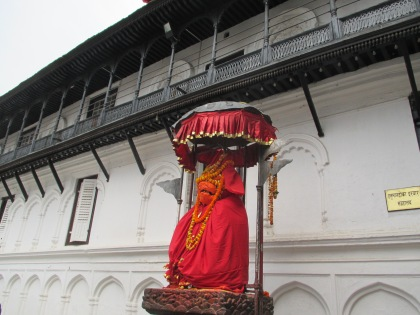 Statue of Hanuman that gives the complex its name. It is covered in orange goo put on by devotees