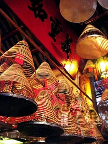 A multitude of incense cones hanging from the ceiling