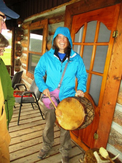 Trying out the hand-made animal hide drum