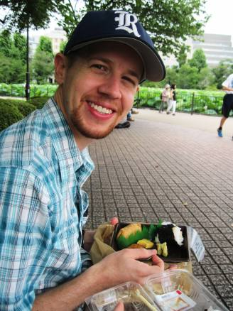 Enjoying a 7-11 breakfast in Ueno Park