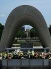 Cenotaph, with eternal flame and A-Bomb Dome in background