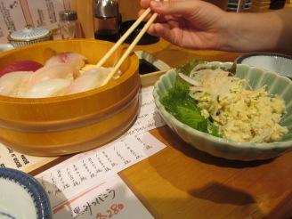 Sushi sampler and potato salad