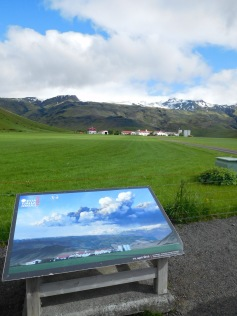Information placard showing the same scene during the eruption