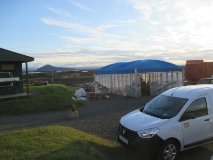 "That's our campervan in our ""camping"" spot in the foreground, and the shared dining area with the blue roof"