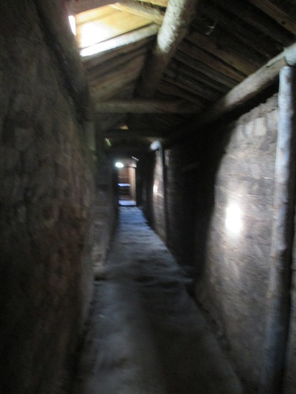 The central hallway with rooms on either side and baðstofa at the end